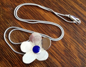 Sterling silver daisy necklace with a resin centre